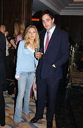 The HON.IMOGEN LLOYD WEBBER daughter of Andrew Lloyd Webber and LORD BUCKHURST at a party to celebrate the re-launch of the Polo bar at The Westbury Hotel, Bond Street, London W1 on 26th April 2005.<br /><br />NON EXCLUSIVE - WORLD RIGHTS