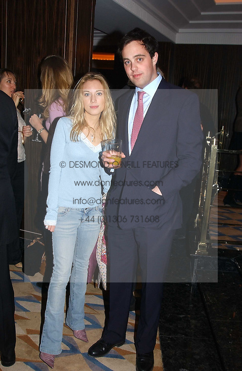 The HON.IMOGEN LLOYD WEBBER daughter of Andrew Lloyd Webber and LORD BUCKHURST at a party to celebrate the re-launch of the Polo bar at The Westbury Hotel, Bond Street, London W1 on 26th April 2005.<br />