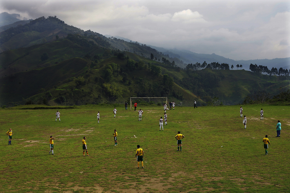 Men play soccer in Salento, a small town in the heart of Colombian coffee country. The tourism industry is slowly emerging in Quindio, the Colombian coffee country.  Old coffee haciendas have been turned into new hotels catering to tourists.  The countryside, some of the most beautiful in the country, is a popular weekend getaway spot where visitors can participate in a variety of outdoor activities as well as learn about coffee production.