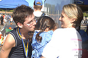 Deb Mosley finishes her triathalon at Lake Berryessa and gets a kiss from 2-year-old Bella. Mosley's time was 2 hours 3 minutes for the half-mile swim, 15-mile bike and 4-mile run...Photo by Jason Doiy.10-9-04.027-2004.