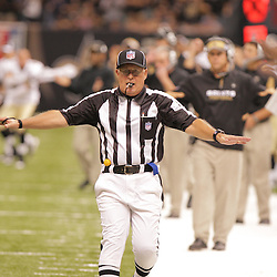 2008 September 7: NFL line judge Ron Phares signals incomplete on a pass to Joey Galloway of the Tampa Bay Buccaneers late in the fourth quarter during the New Orleans Saints home opener against the Tampa Bay Buccaneers at the Louisiana Superdome in New Orleans, LA.  The New Orleans Saints (1-0) defeated the Tampa Bay Buccaneers (0-1) 24-20.