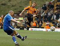 Photo: Ed Godden.<br />Wolverhampton Wanderers v Cardiff City. Coca Cola Championship. 11/03/2006. <br />Darren Purse (L) and Tomasz Frankowski (R) for Wolves.