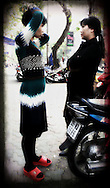 Two Vietnamese woman chat in the street, Hanoi, Vietnam, Southeast Asia