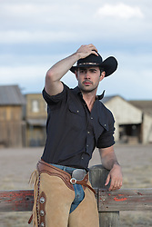 rugged masculine cowboy outdoors on a ranch