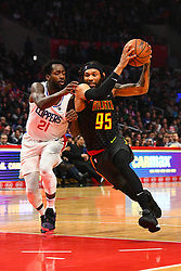 January 29, 2019 - Los Angeles, CA, U.S. - LOS ANGELES, CA - JANUARY 28: Atlanta Hawks Forward DeAndre' Bembry (95) drives to the basket defended by Los Angeles Clippers Guard Patrick Beverley (21) during a NBA game between the Atlanta Hawks and the Los Angeles Clippers on January 28, 2019 at STAPLES Center in Los Angeles, CA. (Photo by Brian Rothmuller/Icon Sportswire) (Credit Image: © Brian Rothmuller/Icon SMI via ZUMA Press)