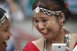 August 9, 2016 - Kathmandu, Nepal - Nepalese women from various ethnic groups react while taking part in a rally to mark International Day of the World's Indigenous Peoples in Kathmandu, Nepal on Tuesday, August 9, 2016. This day is celebrated worldwide to promote and protect the rights of the world's indigenous population. (Credit Image: © Skanda Gautam via ZUMA Wire)