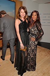 Left to right, GABRIELLA PEACOCK and PHOEBE HITCHOX at the Louis Vuitton for Unicef Event #MAKEAPROMISE held at The Apartment, 17-20 New Bond Street, London on 14th January 2016.