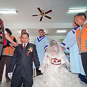 Bunun church elders touch the newly wedded bride and groom to bless them. Namasiya Township, Kaoshiung County, Taiwan