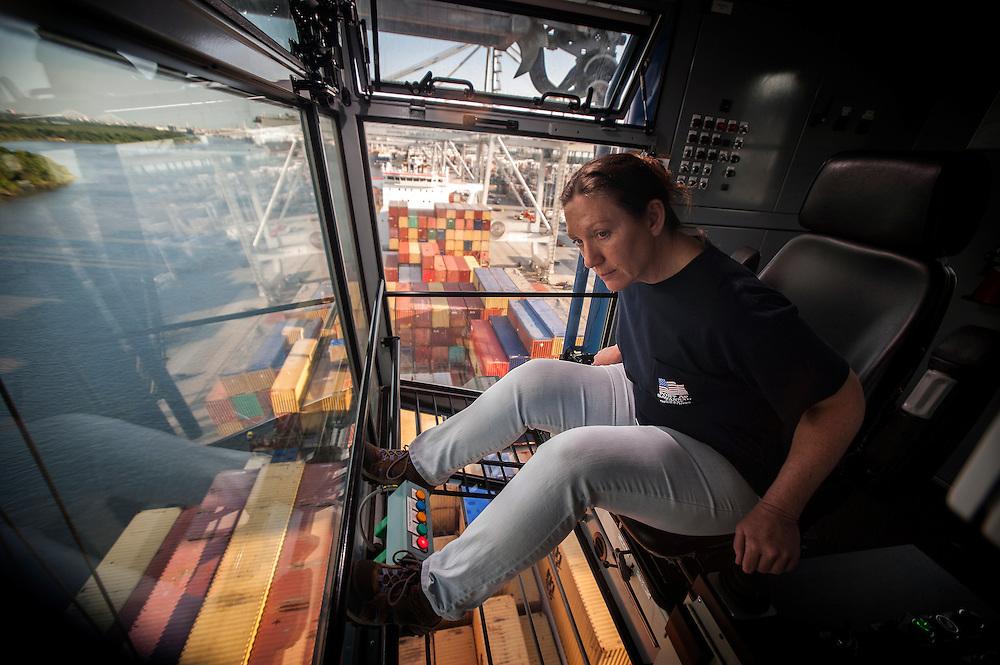 Georgia Ports Authority worker Lisa Tripp operates a Ship to Shore Crane at the port of Savannah, Monday, August 19, 2014, at the Garden City Terminal near Savannah, Ga.  (GPA Photo/Stephen B. Morton)