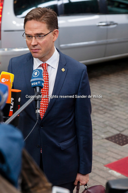 Finland's Prime Minister Jyrki Tapani Katainen speaks with the media as he arrives for an EU summit in Brussels on Friday, Nov. 23, 2012. The prospect of failure hangs over a European Union leaders' summit intended to lay out the 27-country bloc's long-term spending plans. While heavyweights like Britain and France are pulling in opposite directions, smaller members are threatening to veto a deal to make themselves heard.