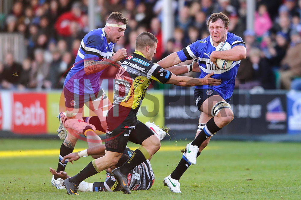 Bath Number 8 (#8) Nick Koster gets away from Calvisano Inside Centre (#12) Tommy Castello with a hand off going on to score a try during the first half of the match - Photo mandatory by-line: Rogan Thomson/JMP - Tel: Mobile: 07966 386802 08/12/2012 - SPORT - RUGBY - The Recreation Ground - Bath. Bath Rugby v Cammi Rugby Calvisano - Amlin Challenge Cup.