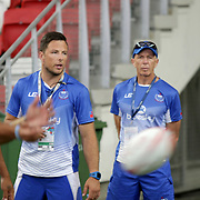 Sir Gordon Tiejtens and his acting trainer son put Manu Samoa thru pregame warmups at the Singapore Sevens, Day 1, National Stadium, Singapore.  Photo by Barry Markowitz, 4/15/17