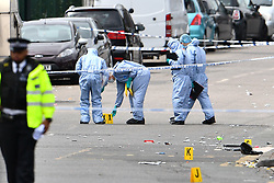 © Licensed to London News Pictures. 29/06/2017. London, UK. The flour lettered with what appears to be nitrous oxide (aka hippy crack) bottles, at the scene where an 18 year old man was stabbed to death at a parrty in Acton West London early this morning. Photo credit: Ben Cawthra/LNP