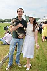 MAX HELMORE and LILY LEWIS with Bobby the dog at the St.Regis International Polo Cup at Cowdray Park, Midhurst, West Sussex on 17th May 2014.