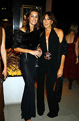 Left to right, model YASMIN LE BON and DONNA KARAN at a party to celebrate the first 20 years of fashion label Donna Karan held at her store at 19/20 New Bond Street, London W1 on 21st September 2004.<br /><br />NON EXCLUSIVE - WORLD RIGHTS