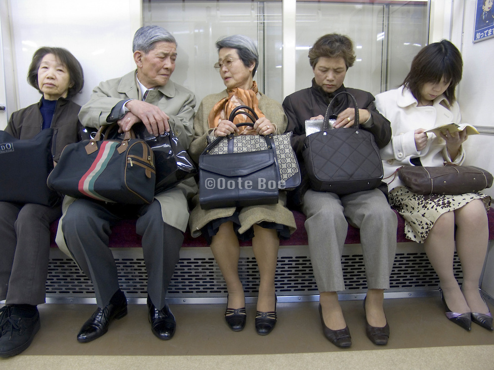 various generation Japanese people sitting in subway Tokyo