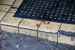 © Licensed to London News Pictures. 13/10/2019. London, UK. Blood stains at the entrance of West Green Halal Meat and Groceries store on West Green Road in Tottenham, North London where two men were stabbed and rushed to hospital shortly after 9.30am this morning. The ages of the two victim and their condition is not yet know. Photo credit: Dinendra Haria/LNP