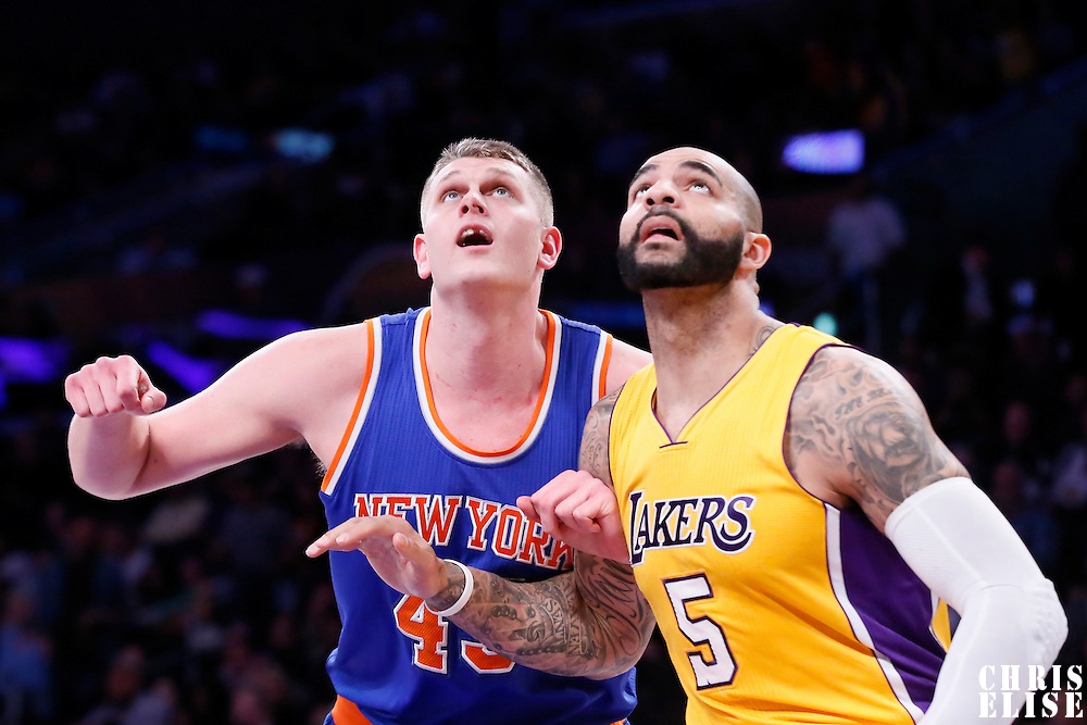 12 March 2015: New York Knicks center Cole Aldrich (45) vies for the rebound with Los Angeles Lakers forward Carlos Boozer (5) during the New York Knicks 101-94 victory over the Los Angeles Lakers, at the Staples Center, Los Angeles, California, USA.