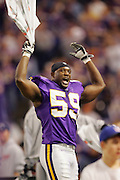 MINNEAPOLIS - NOVEMBER 21:  Linebacker Mike Nattiel #59 of the Minnesota Vikings waves a towel on the bench while getting the fans and his teamates fired up for a fourth quarter comeback win against the Detroit Lions at the Hubert H. Humphrey Metrodome on November 21, 2004 in Minneapolis, Minnesota. The Vikings defeated the Lions 22-19. ©Paul Anthony Spinelli  *** Local Caption *** Mike Nattiel