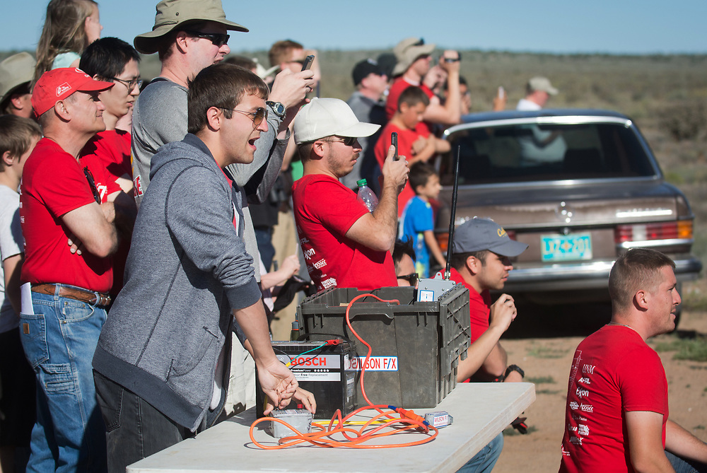 Students in Lobo Launch, a mechanical engineering class at the University of New Mexico, count down just before launching their 47 feet high rocket from their launch site in Rio Rancho, Saturday, May 27, 2017. (Marla Brose/Albuquerque Journal)