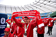 Chorzow, Poland - 2018 June 12: Special Olympics Athlete Mateusz Checinski shows his medals to the audience while Closing Ceremony of National Special Olympics Games 2018 at Slaski Stadium on June 12, 2018 in Chorzow, Poland.<br /> <br /> Adam Nurkiewicz declares that he has no rights to the image of people at the photographs of his authorship.<br /> <br /> Picture also available in RAW (NEF) or TIFF format on special request.<br /> <br /> Any editorial, commercial or promotional use requires written permission from the author of image.<br /> <br /> Image can be used in the press when the method of use and the signature does not hurt people on the picture.<br /> <br /> Mandatory credit:<br /> Photo by © Adam Nurkiewicz / Mediasport