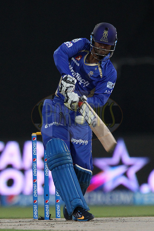 Abhishek Nayar of the Rajatshan Royals launches a six over the top during match 7 of the Pepsi Indian Premier League 2014 between the Rajasthan Royals and The Kings XI Punjab held at the Sharjah Cricket Stadium, Sharjah, United Arab Emirates on the 20th April 2014<br /> <br /> Photo by Ron Gaunt / IPL / SPORTZPICS
