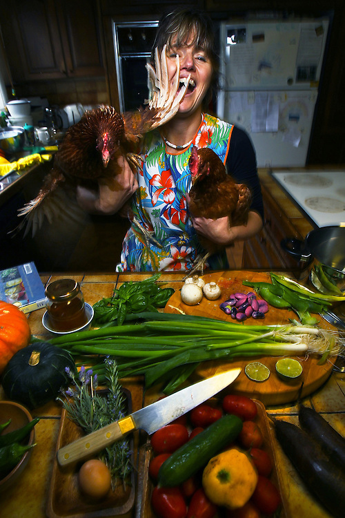 Samantha McGrath, radical homemaker, in her kitchen with two of her chooks and some of her home grown produce which she is cooking in a share cooking arrangement with her neighbours    27/04/2010 Pic By Craig Sillitoe SPECIAL 000 melbourne photographers, commercial photographers, industrial photographers, corporate photographer, architectural photographers, This photograph can be used for non commercial uses with attribution. Credit: Craig Sillitoe Photography / http://www.csillitoe.com<br /> <br /> It is protected under the Creative Commons Attribution-NonCommercial-ShareAlike 4.0 International License. To view a copy of this license, visit http://creativecommons.org/licenses/by-nc-sa/4.0/.