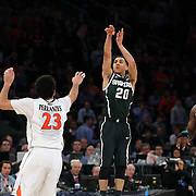Travis Trice, Michigan State, shoots a three during the Virginia Cavaliers Vs Michigan State Spartans basketball game during the 2014 NCAA Division 1 Men's Basketball Championship, East Regional at Madison Square Garden, New York, USA. 28th March 2014. Photo Tim Clayton