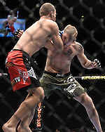"MANCHESTER, ENGLAND, NOVEMBER 14, 2009: Alexander Gustafsson (facing) and Jared Hamman are pictured during ""UFC 105: Couture vs. Vera"" inside the MEN Arena in Manchester, United Kingdom."