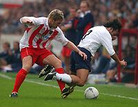 Fotball<br /> 20.07.2004<br /> Premier League<br /> Foto: SBI/Digitalsport<br /> NORWAY ONLY<br /> <br /> Stevenage Borough v Tottenham Hotspur. Pre season friendly.  20/7/04<br /> <br /> Stevenage Borough's Dannie Bulman and Tottenham Hotspur's Mauricao Taricco
