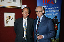 Left to right, MR CHARLIE MAYHEW and SIR PETER O'SULLEVAN at a private view and auction of a collection of paintings, drawings and doodles by well known personalities to mark the Book launch of Ackroyd's Ark in Christie's, 8 King Street, St.James's, London on 20th September 2004 in aid of Tusk Trust.<br />