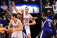 Nov 20, 2013; Phoenix, AZ, USA; Phoenix Suns guard Goran Dragic (1) handles the ball against the Sacramento Kings guard Isaiah Thomas (22) in the frst half at US Airways Center. The Kings defeated the Suns 113-106. Mandatory Credit: Jennifer Stewart-USA TODAY Sports