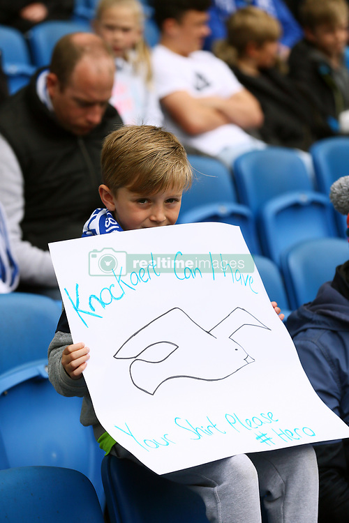 A Brighton and Hove Albion fan with a message for Anthony Knockaert during the Sky Bet Championship match at the AMEX Stadium, Brighton.