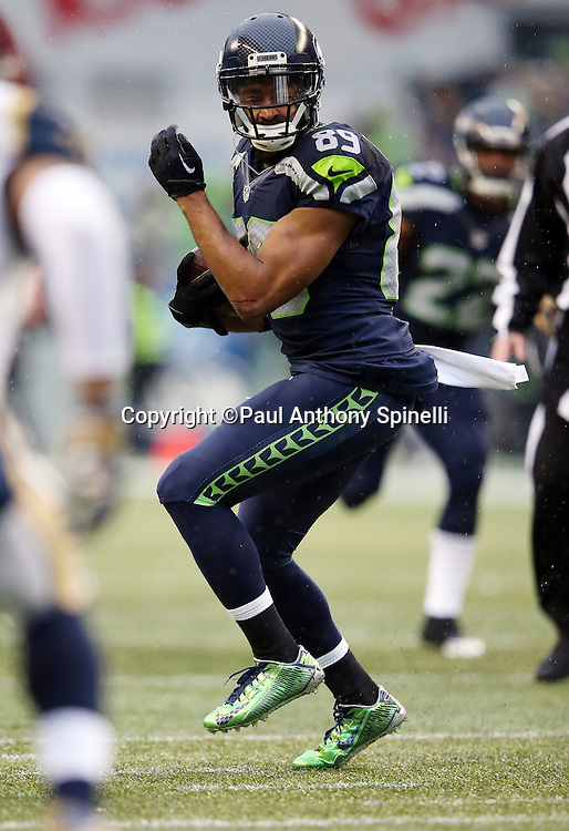 Seattle Seahawks wide receiver Doug Baldwin (89) looks for running room after catching a second quarter pass good for a first down before halftime during the 2015 NFL week 16 regular season football game against the St. Louis Rams on Sunday, Dec. 27, 2015 in Seattle. The Rams won the game 23-17. (©Paul Anthony Spinelli)