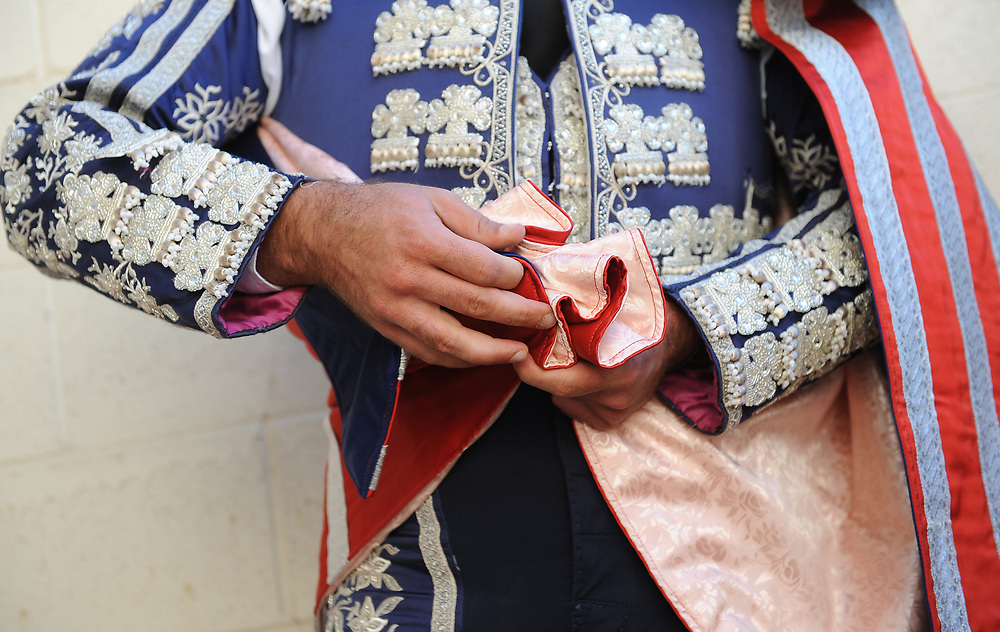 BEA AHBECK/NEWS-SENTINEL<br /> A brega adjusts his outfit during the bloodless bullfight during the Our Lady of Fatima Portuguese Festival in Thornton Saturday, Oct. 14, 2017.