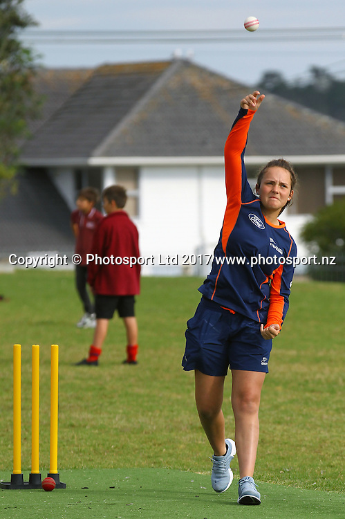 White Ferns Amelia Kerr bowls.<br /> Black Caps Jeet Raval and Mitchell McClenaghan with White Ferns Amelia Kerr and Liz Perry visit Kelston Primary School, Auckland, New Zealand.<br /> 24 February 2017.<br /> Copyright photo: William Booth / www.photosport.nz
