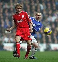 Photo: Paul Thomas.<br /> Liverpool v Everton. The Barclays Premiership. 03/02/2007.<br /> <br /> Dirk Kuyt (L) of Liverpool passes past Tony Hibbert.