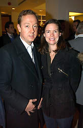 MR & MRS GEORDIE GREIG, he is editor of Tatler at a party to celebrate the 21st year of Hackett held at their store in Sloane Street, London on 26th October 2004.<br />