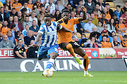 Kazenga LuaLua and Dominic Iorfa battle for the ball during the Sky Bet Championship match between Wolverhampton Wanderers and Brighton and Hove Albion at Molineux, Wolverhampton, England on 19 September 2015. Photo by Alan Franklin.