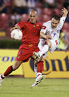 FOOTBALL - WORLD CUP 2006 - QUALIFYING ROUND - GROUP 7 - SERBIA MONTENEGRO v BELGIUM - 04/06/2005 - ROBERTO BISCONTI (BEL) / OGNJEN KOROMAN (SER)<br />