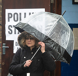 ©Licensed to London News Pictures 12/12/2019. <br /> Bromley ,UK. Lady with an umbrella up outside a polling station. People battle against the wet weather to vote in the UK General Election at St Augustine scout hall, Bromley, South East London.          Photo credit: Grant Falvey/LNP