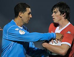 San Marino, San Marino - Wednesday, October 17, 2007: Wales' Gareth Bale and San Marino's Riccardo Muccioli during the Group D UEFA Euro 2008 Qualifying match at the Serravalle Stadium. (Photo by David Rawcliffe/Propaganda)