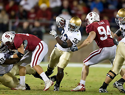 November 28, 2009; Stanford, CA, USA;  Notre Dame Fighting Irish running back Robert Hughes (33) rushes between Stanford Cardinal defensive end Tom Keiser (94) and linebacker Shayne Skov (11)during the first quarter at Stanford Stadium.  Stanford defeated Notre Dame 45-38.