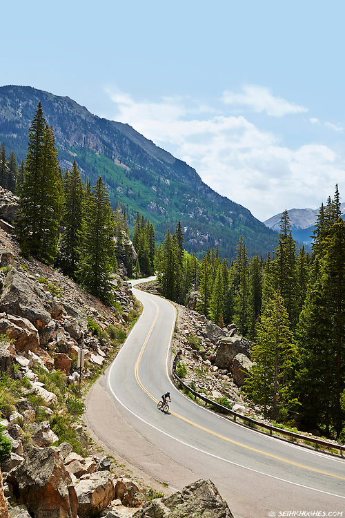 A cyclist cruises down Independence Pass near Aspen, Colorado.