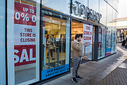 Windsor, UK. 13 February, 2020. A Topshop store in Windsor Yards, a shopping area in the heart of the historic town, displays closing down notices. A nearby New Look store is also earmarked for closure and Timberland and Lakeland stores have been closed in Windsor Yards since the New Year. The closures are indicative of difficult trading conditions for high-street retail.