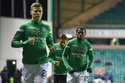 22 Florian Kamberi and 25 Efe Ambrose warm up for the Ladbrokes Scottish Premiership match between Hibernian and Rangers at Easter Road, Edinburgh, Scotland on 19 December 2018.