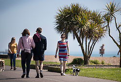 © Licensed to London News Pictures. 05/05/2018. Worthing, UK. Visitors enjoy the sunshine on the sea front at Worthing. Record temperatures are expected this bank holiday weekend. Photo credit: Peter Macdiarmid/LNP