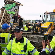 13 local activists locked themselves in specially made arm tubes to block the entrance to Quadrilla's drill site in New Preston Road, July 03 2017, Lancashire, United Kingdom. Police forcing protestors away fro the gates. Activists up the make-shift tower prevent police form clearing that. The 13 activists included 3 councillors; Julie Brickles, Miranda Cox and Gina Dowding and Nick Danby, Martin Porter, Jeanette Porter,  Michelle Martin, Louise Robinson,<br />