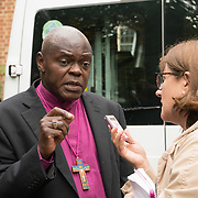 London, England, UK. 27th July 2017. Archbishop of York, John Sentamu talk to reporter at the memorial for The Late Mary Mendy, Khadija Saye, Berkti Haftom, Beruk Haftom, and Isaac (Welde Mariam) Grenfell Tower victims St Helen Church, North Kensington.