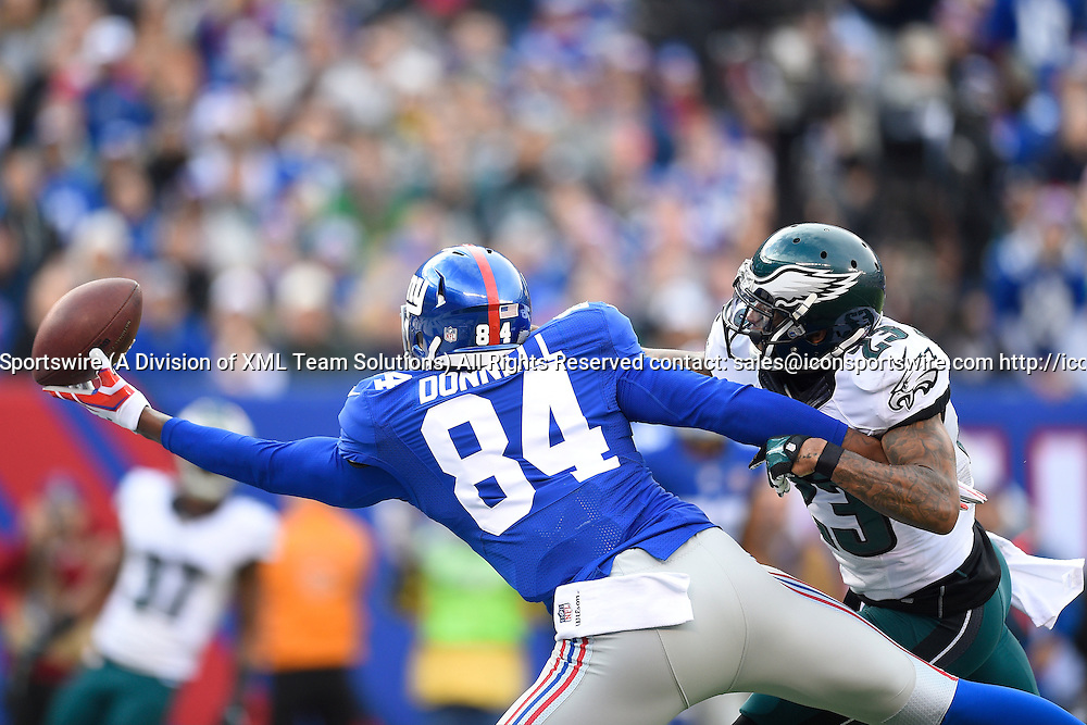 December 28, 2014: New York Giants tight end Larry Donnell (84) reaches for a pass as Philadelphia Eagles cornerback Nolan Carroll (23) defends during the first half of a NFL Eastern matchup between the Philadelphia Eagles and the New York Giants at MetLife Stadium in East Rutherford, New Jersey.